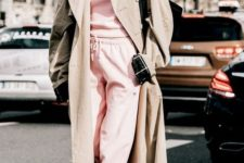 15 a pink track suit, white trainers, an oversized beige trench and a black bag