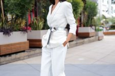 15 a white pantsuit with no top under, a silver belt to highlight the waist and nude heels