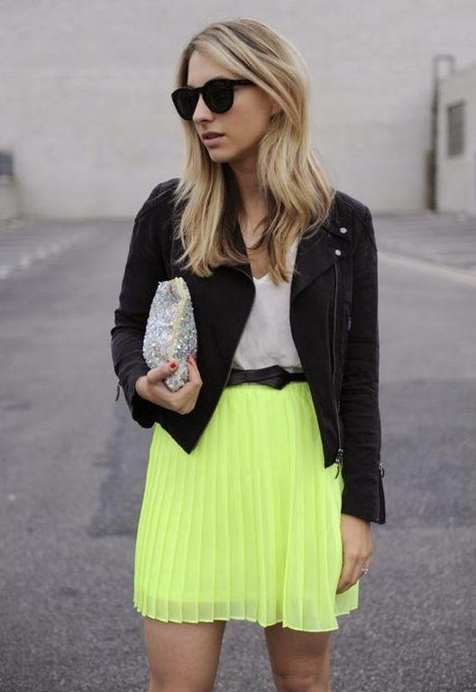 a white tee, a neon green pleated mini, a black denim jacket