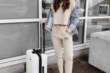 15 an ivory tracksuit with a cropped top, white sneakers, a denim jacket