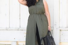 15 black leggings, an olive green tunic with no sleeves, black heels and a black bag