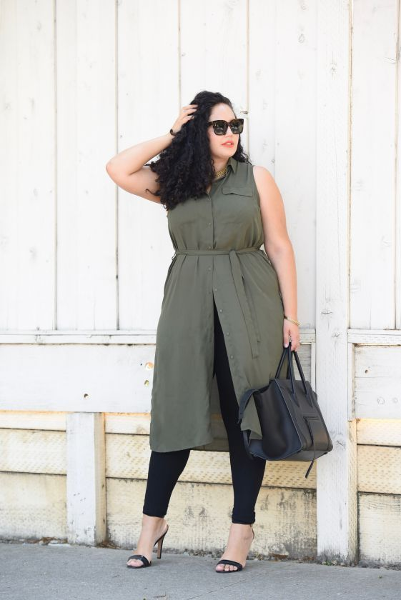 black leggings, an olive green tunic with no sleeves, black heels and a black bag