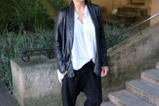 15 black pants, an oversized shirt, a black leather jacket and black pointed toe flats