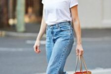15 blue mom jeans, a white tee, white sneakers and a sandy beige bag