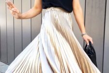 16 a black spaghetti strap top, a metallic pleated midi skirt, black shoes and a small bag