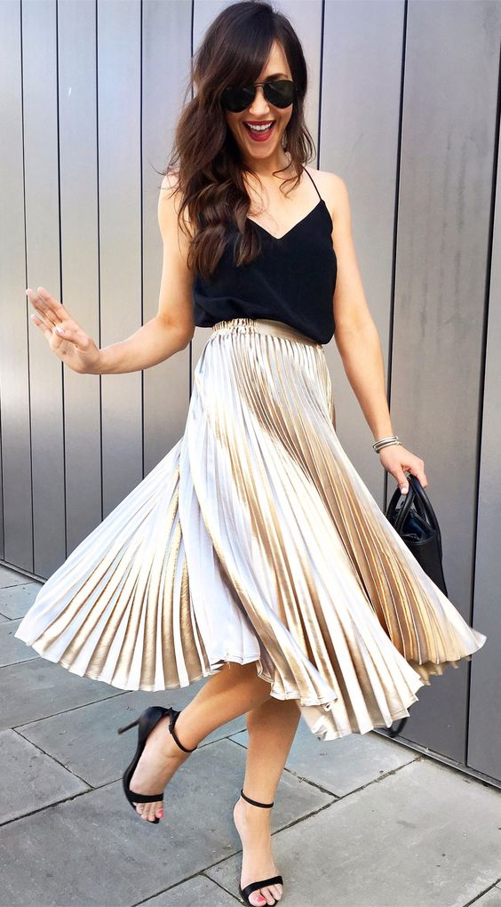a black spaghetti strap top, a metallic pleated midi skirt, black shoes and a small bag