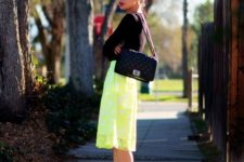 16 a neon yellow lace midi, a black long sleeve top, black shoes and a black Chanel bag