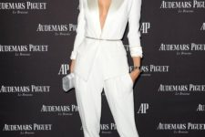 16 a white pantsuit with shiny lapels and no top under it, shiny shoes and a silver clutch for a statement