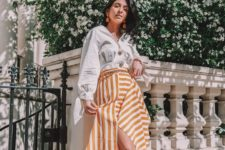 16 a white shirt, a striped yellow and white midi skirt, cremay and black slingbacks