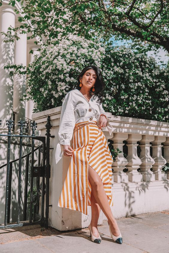 a white shirt, a striped yellow and white midi skirt, cremay and black slingbacks
