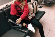 16 black leggings, striped socks, white sneakers, a red hoodie and a crossbody with a red touch