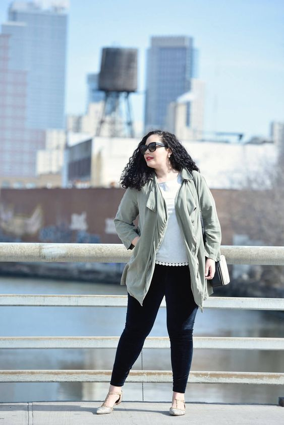 black velvet leggings, a white tee with pompoms, studded flats and an olive green jacket