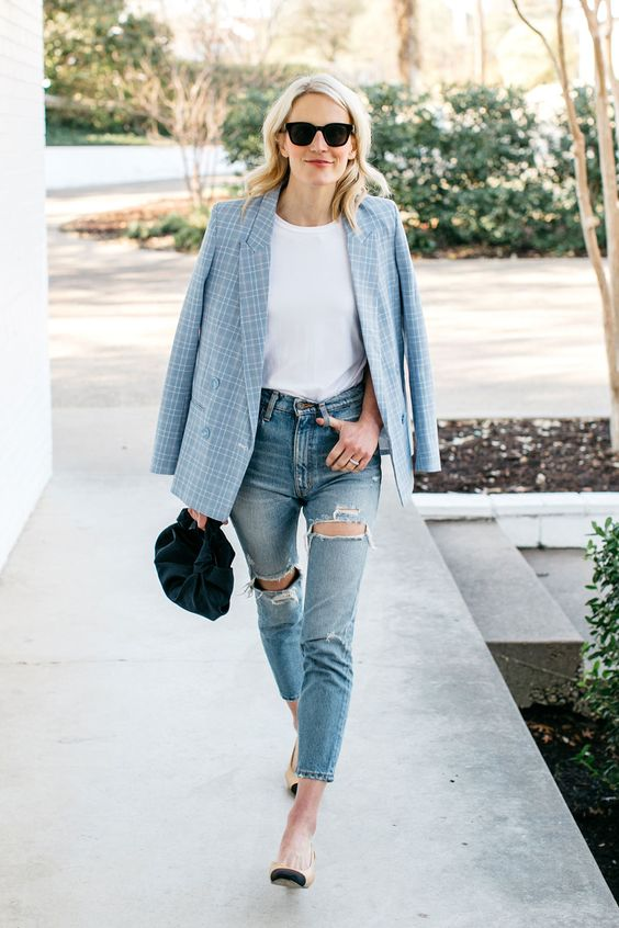 blue ripped jeans, a white tee, a blue printed blazer, heels and a small velvet bag