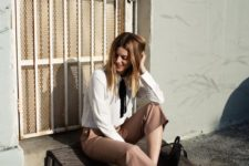 16 cropped camel pants, a white blouse with a black bow, black shoes and a black bag