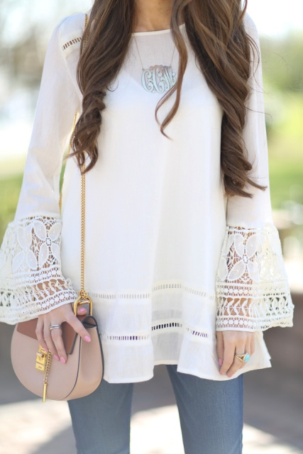 With beige chain strap bag and jeans