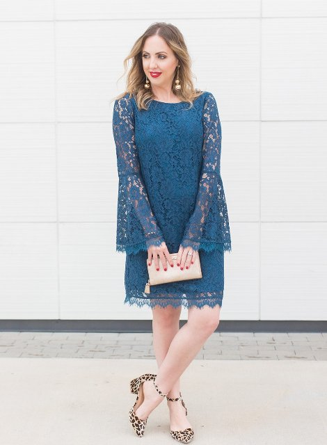 With beige clutch and leopard ankle strap shoes