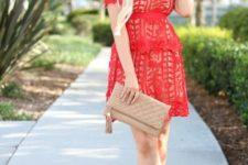 With beige leather clutch and beige pumps