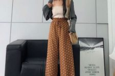 With beige top, gray jacket, beige bag and lace up shoes