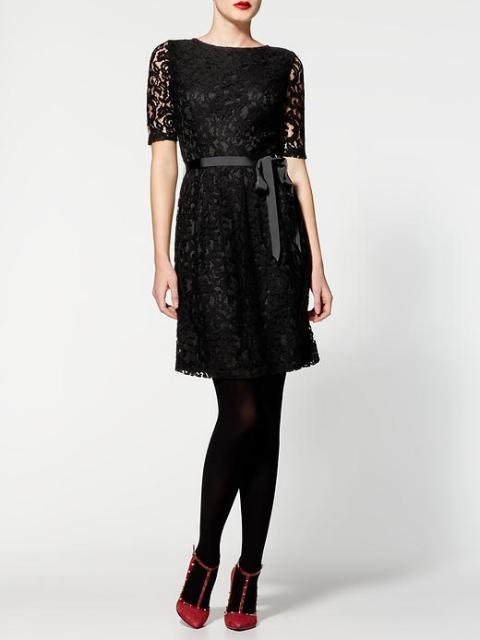 With belt, black tights and marsala shoes