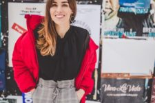 With black blouse and red crop jacket