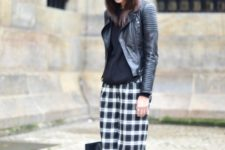 With black blouse, black leather jacket, black shoes and tote