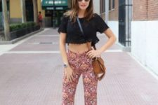 With black crop top, platform shoes and brown crossbody bag