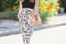 With black crop top, printed clutch and gray shoes