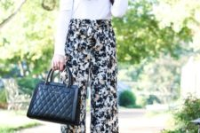 With black hat, white shirt, black leather bag and beige shoes