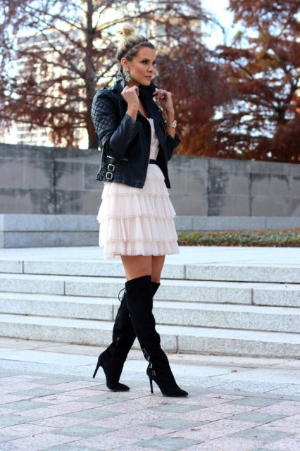 With black leather jacket, black over the knee boots and black belt