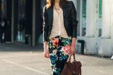 With black leather jacket, button down shirt, leather bag and ankle boots