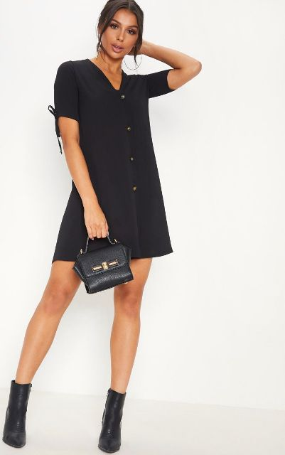 With black leather small bag and black ankle boots