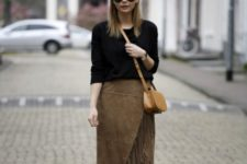 With black loose sweater, black ankle boots and crossbody bag