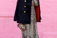 With black mini coat, leopard clutch and pale pink shoes