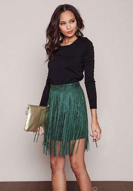 With black shirt and metallic clutch