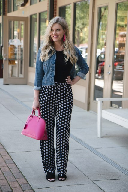 With black shirt, denim jacket, pink bag and cutout shoes