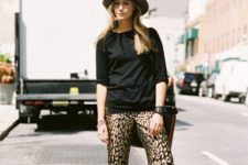 With black shirt, wide brim hat, bag and high heels