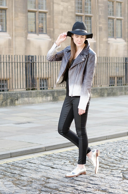 With black shirt, wide brim hat, black pants and silver shoes