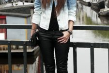 With black t-shirt, black skinny pants, black clutch and high heels