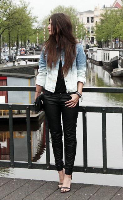 With black t-shirt, black skinny pants, black clutch and high heels