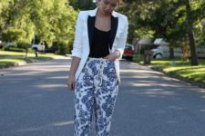 With black top, black and white blazer and golden shoes