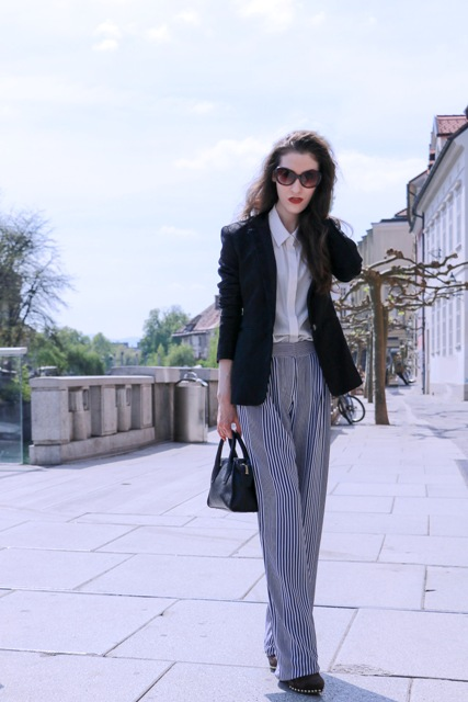 With blouse, black blazer, black mini bag and shoes