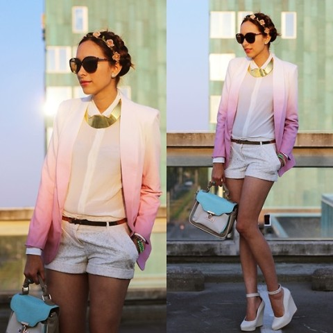 With blouse, white shorts, sunglasses, white platform shoes and two colored bag