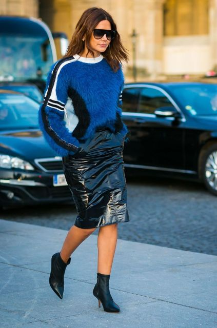 With blue, white and black sweater and black ankle boots