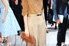 With brown button down shirt, brown fringe clutch and beige shoes