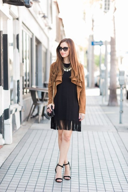 With brown jacket, chain strap bag and heels