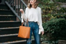 With cropped jeans, brown tote bag and beige pumps