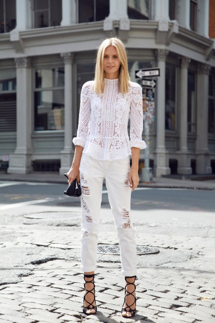 With cuffed trousers, black bag and lace up shoes