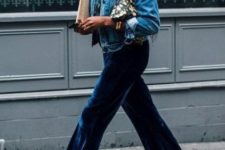 With denim jacket and floral clutch