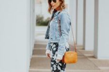 With denim jacket, orange bag and white sneakers
