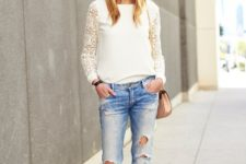 With distressed jeans, oversized sunglasses, small bag and high heels